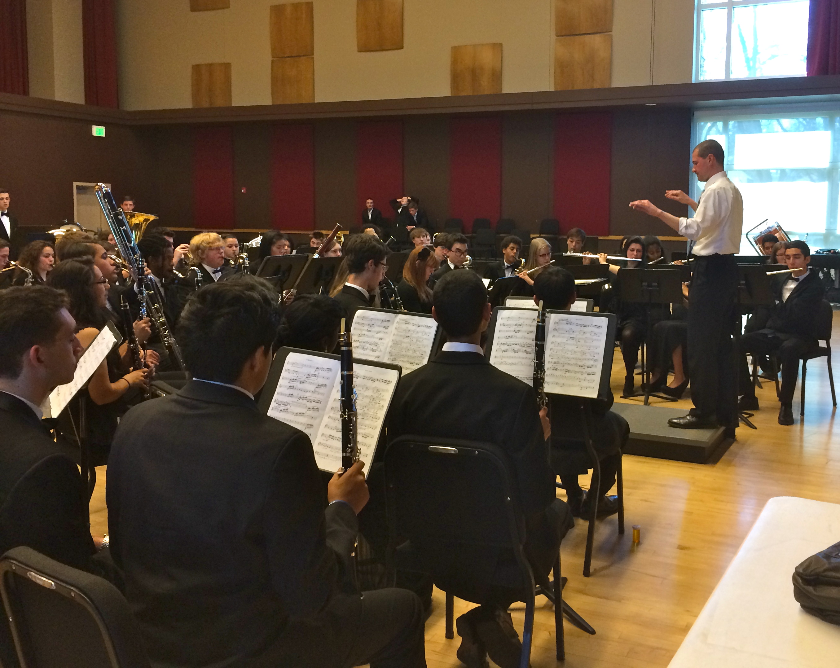 Dr. David Kish works with the DSA Wind Ensemble after their performance at State Concert Band Festival in Ft. Collins.