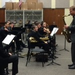 CU saxophone instructor John Gunther plays an example for the band in the clinic.