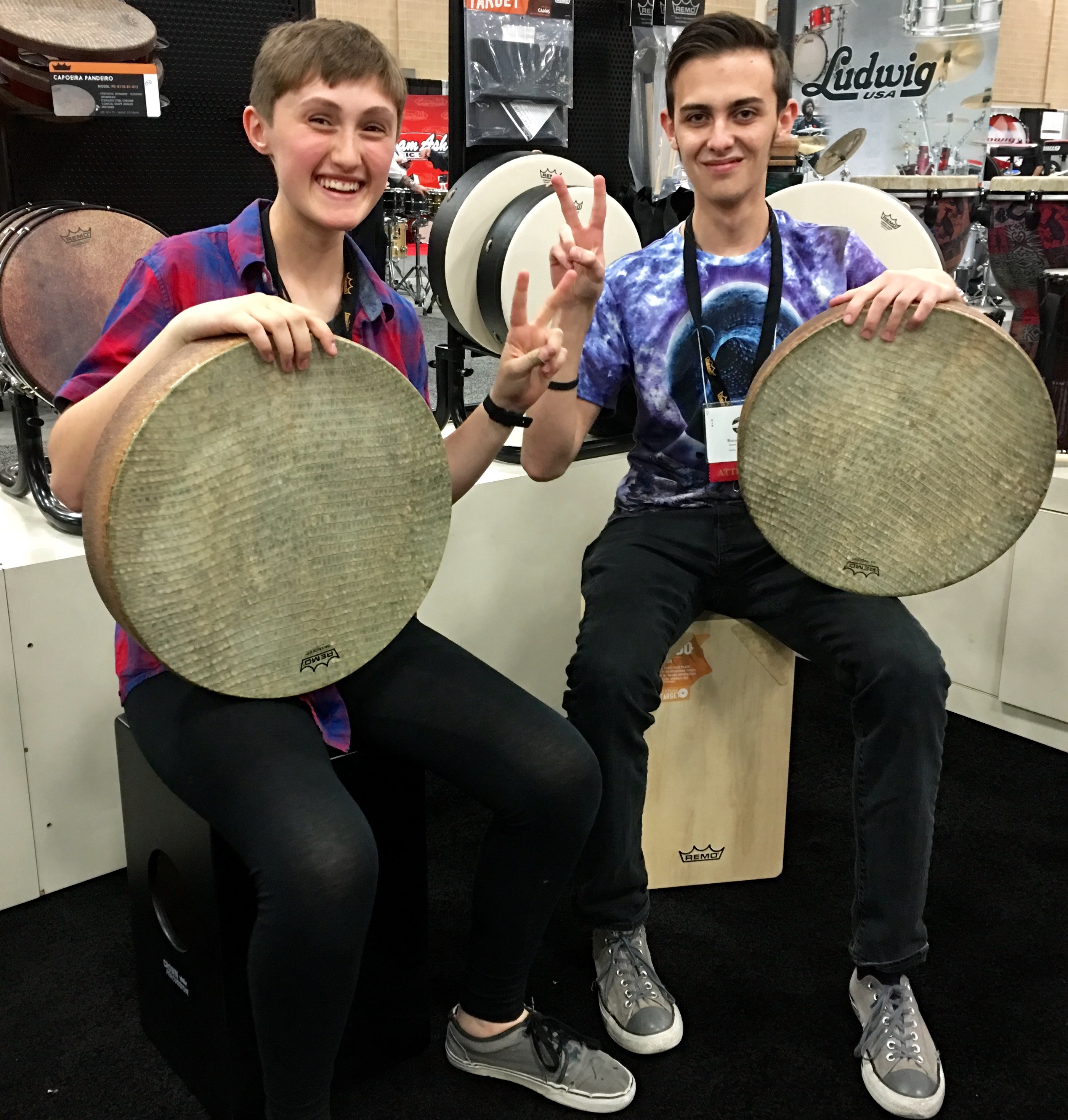 On a recent trip to the Percussive Arts Society convention in San Antonio, TX Gabby Costache and Rocco Williams share a moment testing hand drums.
