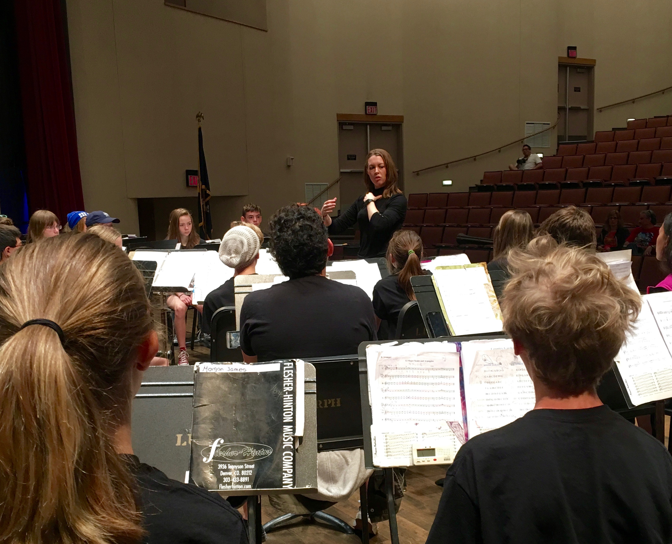 Dr. Serena Weren, Director of Bands at Loyola University works with the Concert Band in clinic.works with the